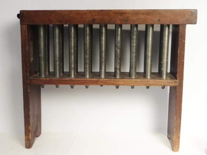 Large framed candle mold with 18 pewter tubes